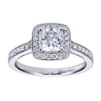A white gold and round brilliant diamond creation that will have the round center diamond sparkling in this vintage halo engagement ring.