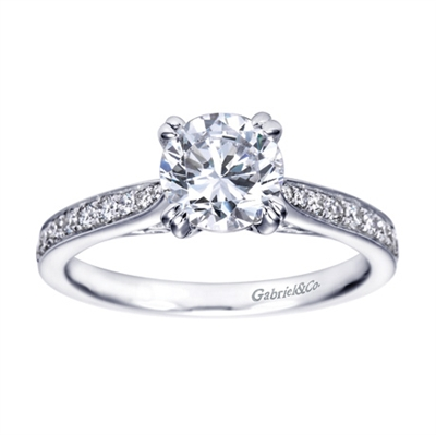A simple design with an over the top look! this contemporary engagement ring in white gold is sure to impress.