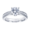 A modern day take on a victorian style engagement ring with round brilliant diamonds.