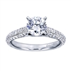 A Round center diamond perfectly compliments the straight band of this contemporary white gold diamond engagement ring.
