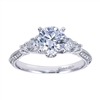 A 3 stone diamond engagement ring with intricate metal work and a flair for the dramatic.