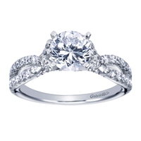 A stunning white gold contemporary criss cross engagement ring with half a carat in round diamonds glistening over the shank of this stylish engagement ring.