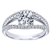 This uniquely style diamond engagement ring with a split shank band features over one half carats of round brilliant diamonds!