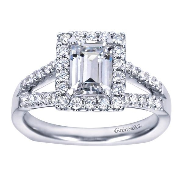 268869231d78 This split shank halo engagement ring perfectly houses an emerald cut  center diamond with nearly one