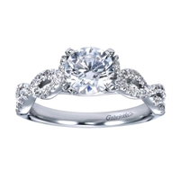 This diamond strewn contemporary criss cross diamond engagement ring lights up with one third carats of round brilliant diamonds and a twisted and criss crossing diamond bands lead up to a round diamond.