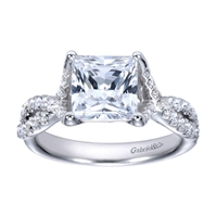 A princess cut center diamond sits in the middle of criss cross split shank bands, all covered in round brilliant diamonds in this platinum criss cross engagement ring.