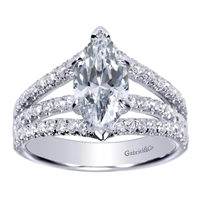 This marquise shaped diamond split shank engagement ring features nearly one carat of round brilliant diamonds is offered in white gold or platinum.