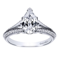 This diamond encrusted engagement ring holds a pear cut center diamond and holds 1/3  carats of round diamonds in its split shank diamond engagement ring setting.