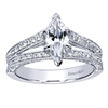 This artistically worked split shank diamond engagement ring fits a classic marquise cut diamond in this white gold or platinum split shank marquise diamond engagement ring.
