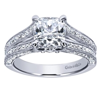 This artistic diamond engagement ring with 2/3 carats round brilliant diamonds is made especially for a cushion cut diamond.