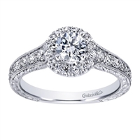 This beautifully done diamond engagement ring comes with sleek metal work and a round center diamond included! She'll scrream with delight when she sees this modern diamond halo engagement ring!
