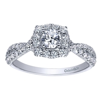 This unique and well crafted vintage style halo engagement ring features a split shank full of round brilliant diamonds and includes a round center diamond!