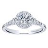 This white gold diamond engagement ring comes with a round center diamond and a beautiful round diamond halo to hold in all that shine!