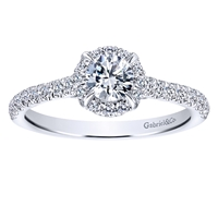 This stunning round diamond halo engagement ring features nearly one full carat of round diamonds and is included with a center diamond!