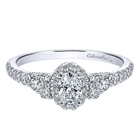 This 14k white gold diamond promise ring features nearly 3/4 carats of diamonds in an elegant style.