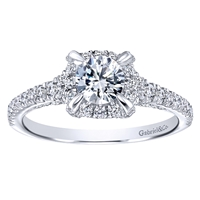 This shimmering and splendidly diamond encrusted halo engagement ring glimmers with nearly one carat of round brilliant diamonds in this diamond engagement ring including the center diamond.
