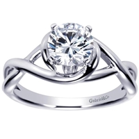 This twisted and clever solitaire engagement ring features a criss cross engagement ring shows off and highlights a round center diamond.