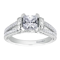 This diamond studded split shank princess cut diamond engagement ring glistens with 0.39 carats of round brilliant diamonds, all cushioning a princess cut center diamond.