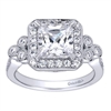 Two sets of triple round diamonds offset this diamond halo engagement ring for a princess cut center diamond. With over one half carats for round diamonds, this engagement ring has plenty to stare at!