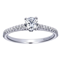 This stunning showcase favorite includes a round center diamond alongside side round diamonds, delivering the glimmer.