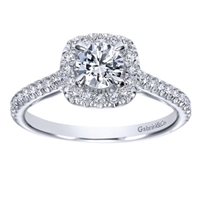 This round brilliant diamond halo engagement ring features a round center diamond and side round diamonds all included in this engagement ring!