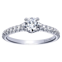This chic and stylish straight round diamond engagement ring comes complete with a round center diamond that delivers the message.
