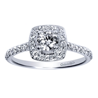 This sleek and shimmering 14k white gold diamond halo engagement ring features an included center diamond to make this the easiest decision of your life!