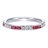 This 14k white gold diamond and ruby stackable ring has 0.39 carats of round brilliant diamonds and 1/3 carats in baguette shape rubies.