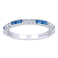 Sapphires line up with diamonds over 14k white gold in this sapphire and diamond stackable ring featuring one third carats in sapphire and almost one half carats in round diamonds.