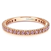 A row of pink sapphires set into 14k rose gold in this stackable ring.