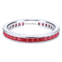 Gorgeous princess cut rubies are set into 14k white gold in this channel set 14k white gold ruby stackable ring.