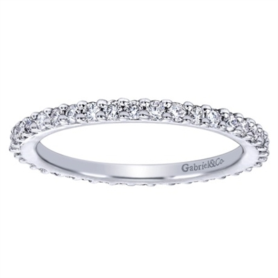 This well crafted 14k white gold diamond band stackable ring is a perfect compliment to a more intricate stackable ring.