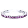 This 14k white gold stackable ring features a row of purple amethysts.