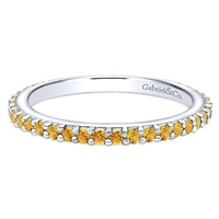 This 14k white gold stackable ring features citrine stones.
