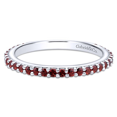 A garnet stackable ring in 14k white gold.