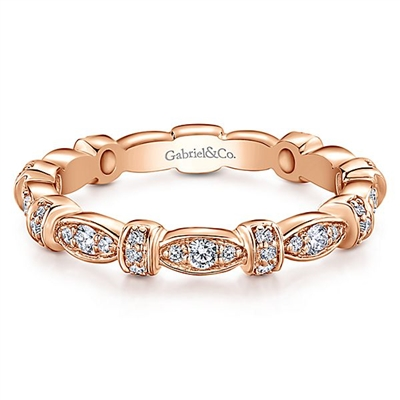 A 14k rose gold diamond stackable ring with 0.27 carats of diamonds.