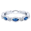 This 14k white gold diamond stackable ring features sapphires and diamonds.