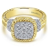 This yellow and white gold diamond ring contains one half carats in round brilliant diamonds all set around the center of this diamond rope ring.