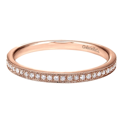 This 14k rose gold diamond stackable ring features round brilliant diamonds set in a delicate and modern rose gold band.