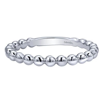 This simple and cool beaded stack ring comes in 14k white gold and teams up well with others!