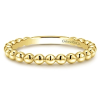 This 14k yellow gold stackable ring features beads.