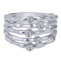 This sterling silver and white sapphire ring with 5 bands to amplify the look.