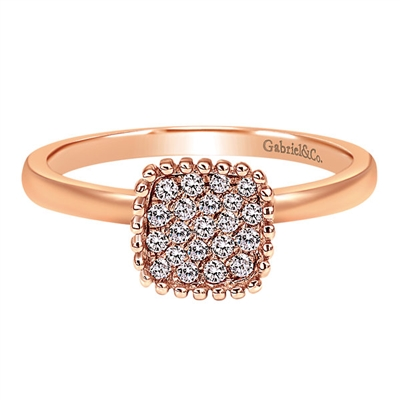 This rose gold fashion ring set with round brilliant diamonds features nearly one quarter carats of round brilliant diamonds set in a center cluster setting.