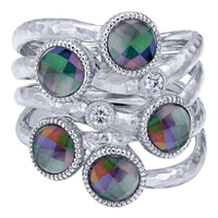 This sterling silver fashion ring glows with the multi color stones set into it.