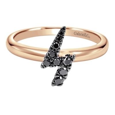 Black diamonds shine over pink gold in this creative and funky lightning bolt ring.