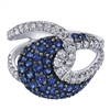 Sapphires and round diamonds intermingle in this fantastic and complex sapphire and diamond fashion ring.