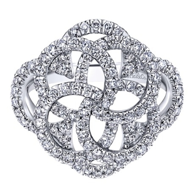 A swirling and spiraling round brilliant diamond masterpiece, shimmering and shining over 14k white gold in this mystic wheel diamond fashion ring.