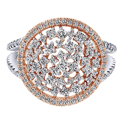 This funky diamond ring in 14k white and rose gold features one carat of diamond shimmer to match the fashion ring allure.