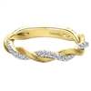 This unique 14k yellow gold diamond twist ring features 0.20 carats of diamonds.