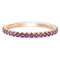 This 14k rose gold stackable ring features purple amethyst.